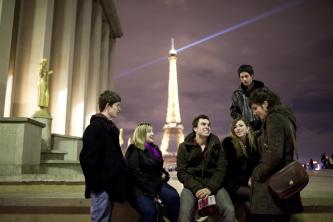 Students talking with the Eiffel Tower in the background